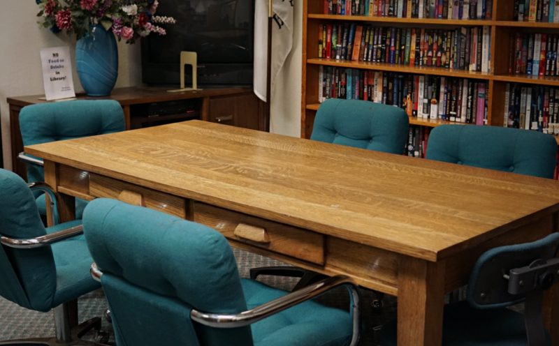 conference table, chair, and background view of bookshelf